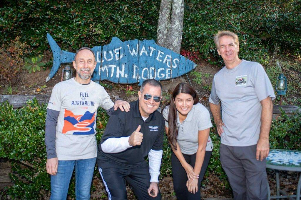 Men and woman outside Blue Waters lodge in Smoky Mountains