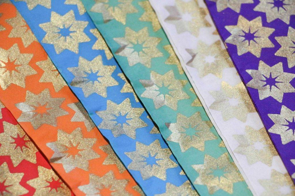 Colourful gold star wrapping paper